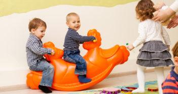 Children on the rocking seesaw